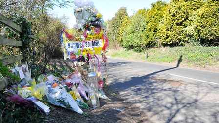 Memorials laid on Wolvershill Rd at the site of Fiona Braidwood's fatal car accident.