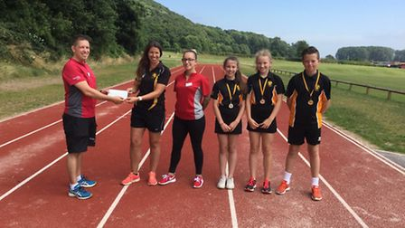 Winners being presented with medals after school sports day.