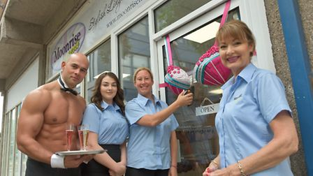 Owner Tanya Hall cutting the big bra to open doors. Pictured with her staff Kiera Cavey and Veronica
