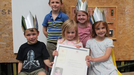 Children from Rainbows Preschool in Backwell with their royal letter.