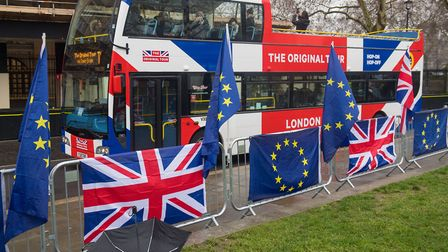 A tour bus passes anti-Brexit banners outside the Houses of Parliament. Photograph: Dominic Lipinski