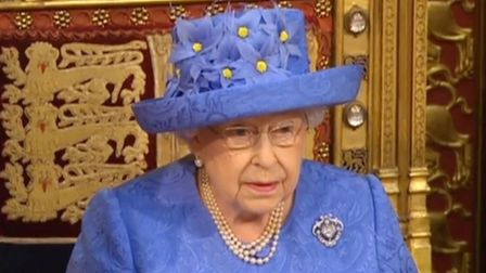 The Queen in blue and yellow at the state opening of parliament in 2017
