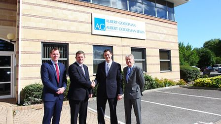 Picture outside Albert Goodman Lewis new Weston-super-Mare offices are Chris Lewis, Richard Bugler,