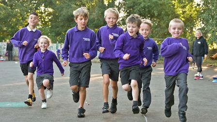 Pupils at St Andrew's School, Congresbury, taking part in their 'morning mile' run around the playgr