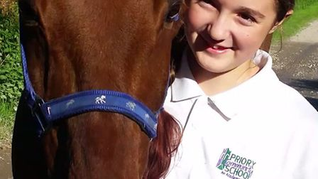 Makayla Nunn and her horse Tommy.