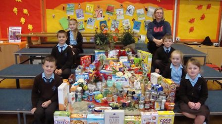 Generous pupils from St Francis Primary School in Nailsea with their donations from the harvest fest