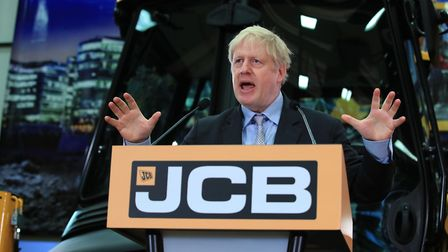 Boris Johnson speaking at the headquarters of JCB in Rocester, Staffordshire. Photograph: Peter Byrn
