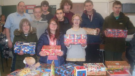 Ravenswood School pupils donating gifts to the Salvation Army.