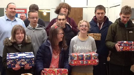 Kind pupils from Ravenswood School donating gifts to the Salvation Army Christmas appeal.