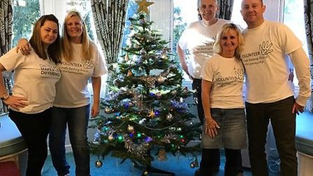 Lloyds staff with one of the decorated trees.