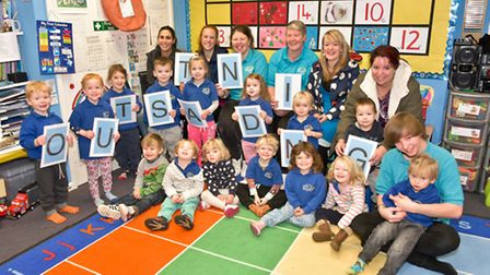 Staff, parents and pupils at Little Sparklers which has been given an outstanding Ofsted rating.