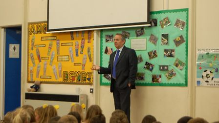 Dr Liam Fox speaking to pupils from High Down Junior School.