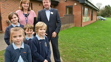 Headteacher Jane Bennett and Mike Usher MD of TPS Construction with members of the school council.