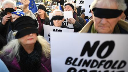 People's Vote supporters wearing blindfolds and carrying placards assemble in Parliament Square ahead of the Brexit debate...