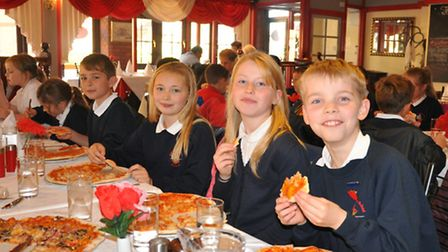 Students from Grove Junior School celebrating their successful business project with a meal.