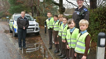 St Francis School, Nailsea. School launching road safety campaign. Pupils, and police near busy road