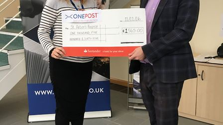 ONEPOST presenting their earnings to St Peter's Hospice
