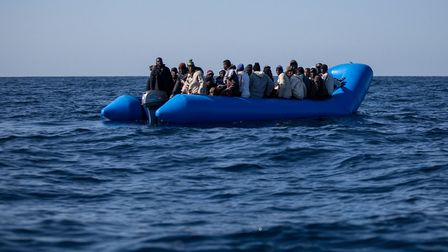 An inflatable boat with 47 migrants on board is pictured while being rescued by the Dutch-flagged Se