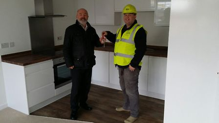 Site manager Peter Newnes handing over the keys to Rob Stokell centre manager for Crown Glass shoppi