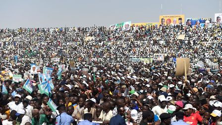 Supporters attend the ruling All Progressives Congress' (APC) candidate, incumbent President Mohamma