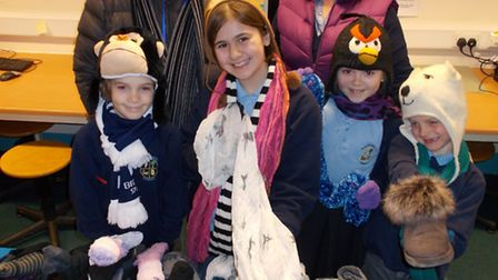Pupils from Flax Bourton Primary School with their hats adn gloves for the homeless.