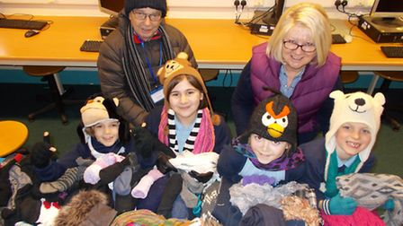 Children from Flax Bourton Primary School with their collection of hats, gloves and scarves for the