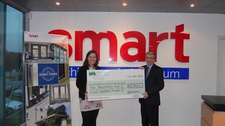 Guy Morris, of Smart, presenting the cheque to Children's Hospice South West,