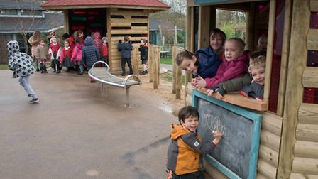 Children with new outdoor play equipment.