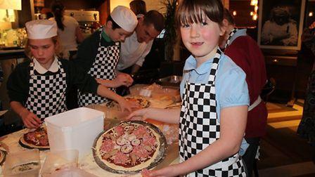 Jessica Fuller with her sausage, pepperoni, mushrooms and red onions.