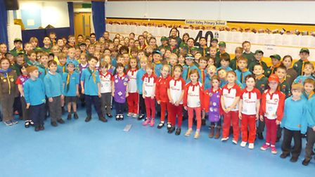 Pupils from Golden Valley Primary School wearing their rainbow, beaver, cub, brownie, scout and guid
