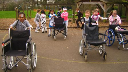 Children taking part in a sponsored bed push.