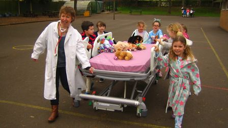 St Francis Primary School holding a sponsored bed push.