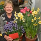 Joan Pittock with a collection of her prize winning flowers.