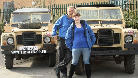 Paul Casey and Saz Casey with their freshly restored Land Rovers.