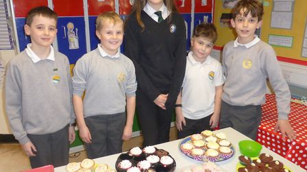 Jasmine and Jake selling cakes with their friends.
