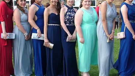 Glamorous girls ready to head off to their prom.