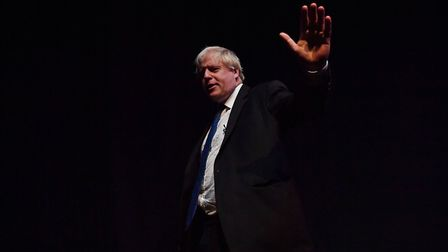 Boris Johnson waves after giving a speech during a fringe event on the sidelines of the third day of