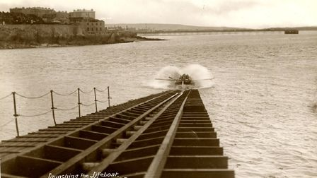 RNLB Colonel Stock launches down the slipway c.1910. The Grand Pier's extension can be seen in the d