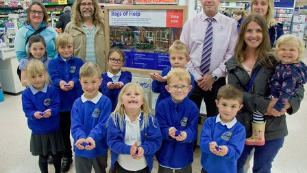 Parents and pupils visiting Clevedon Tesco, pictured with Store manager Mike Wheatley.