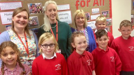 Yeo Moor Primary School pupils and staff have been praised for the helping the school be recognised.
