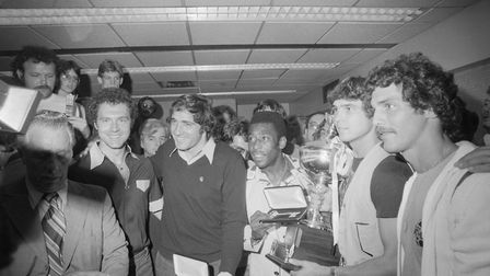 Members of the New York Cosmos, winners of the 1977 NASL Championship, pose with their trophy and ke