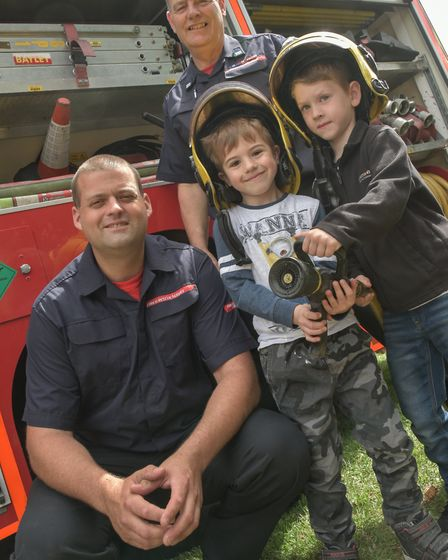 Fire fighters Steve Morgan and Eric Pimm with Harley and Thomas.