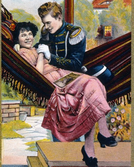 Trading card depicting a couple in a hammock, circa 1909. (Photo by: Universal History Archive/UIG v