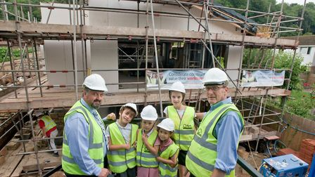 Head teacher Stephen Webber and pupils Jack, Evie, Milly and Maddie, with TPS Contractors site manag