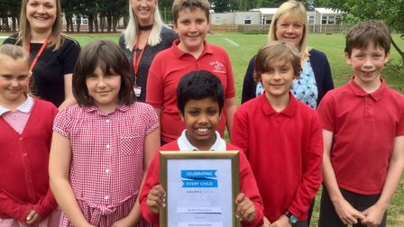 Yeo Moor Primary School students and staff with their certificate.