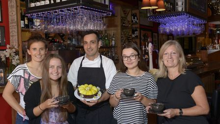 Marco (centre) and co-owner Chris Yeatman (far right) with customers at Patisserie Venga. Picture: P