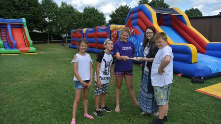 Children paying back the £100 loan following the Yattonbury event.
