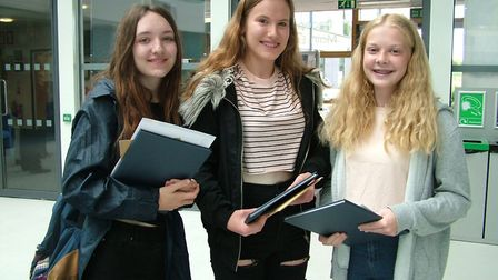 Emily Furneaux, Hannah Thomas and Abigail James picking up their results from Nailsea School.