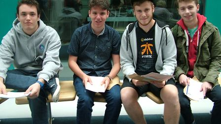 Thomas Flaherty, Alberto Rivera, Jake John and Travis Bird picking up their results at Nailsea Schoo