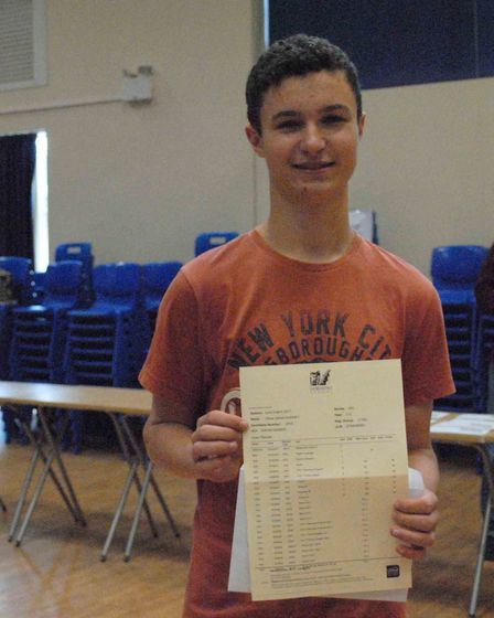 Oliver with his exam results.